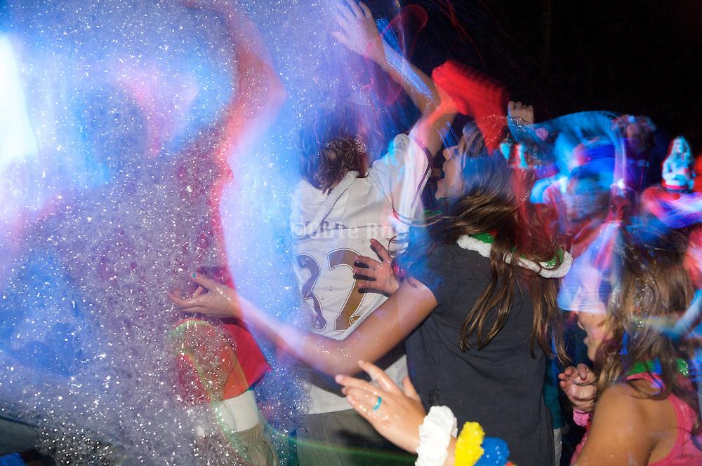 teenagers enjoy a foam party