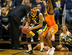 Feb 10, 2018; Morgantown, WV, USA; West Virginia Mountaineers guard James Bolden (3) looks to pass while defended by Oklahoma State Cowboys guard Brandon Averette (0) during the first half at WVU Coliseum. Mandatory Credit: Ben Queen-USA TODAY Sports
