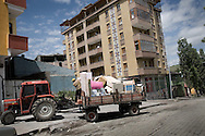Family moving into the new house in the Kars center...Kars is a main city of the region but still maintains very agriculture feel to it. On the bazaar one could see tractors and agriculture machinery as a main product for sale..