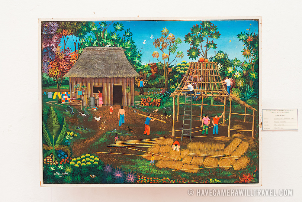 The painting is titled Construccion Campesina, 1987, and was painted by Amilcar Mendieta. The The Centro Cultural Convento San Francisco, located just a couple of blocks from Parque Central in Granada, is dedicated to the history of the region.