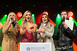 © Licensed to London News Pictures . 07/11/2015 . Manchester , UK . CATHERINE TYLDESLEY and KYM MARSH push the plunger to set off the fireworks in Albert Square at 8pm for the Christmas Lights switch on at Manchester Town Hall . Photo credit : Joel Goodman/LNP