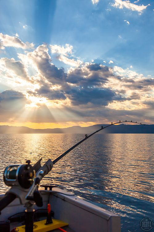 """""""Fishing Pole at Lake Tahoe 10"""" - Photograph of a fishing pole at Lake Tahoe with crepuscular rays in the sky. Shot near sunrise during the annual Jakes on the Lake charity fishing derby."""