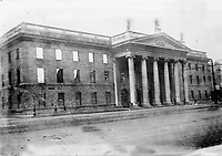 The ruins of the General Post Office (GPO) on Sackville (O'Connell) St. Having been reopened after extensive renovations some weeks prior to the Easter Rising, it was used as the headquarters garrison and was destroyed by fires. The outer walls remained intact and the GPO repoened in 1929. (Part of the Independent Newspapers Ireland/NLI Collection)