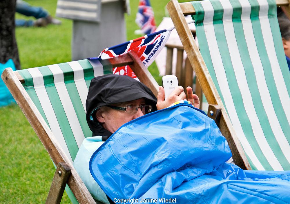 People celebrating Queen Elizabeth's 90th birthday celebrations in St James Park London