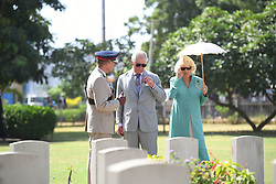 The Prince of Wales and the Duchess of Cornwall during a visit to the Commonwealth War Graves, Banjul in The Gambia, on day two of the royal couples trip to west Africa.
