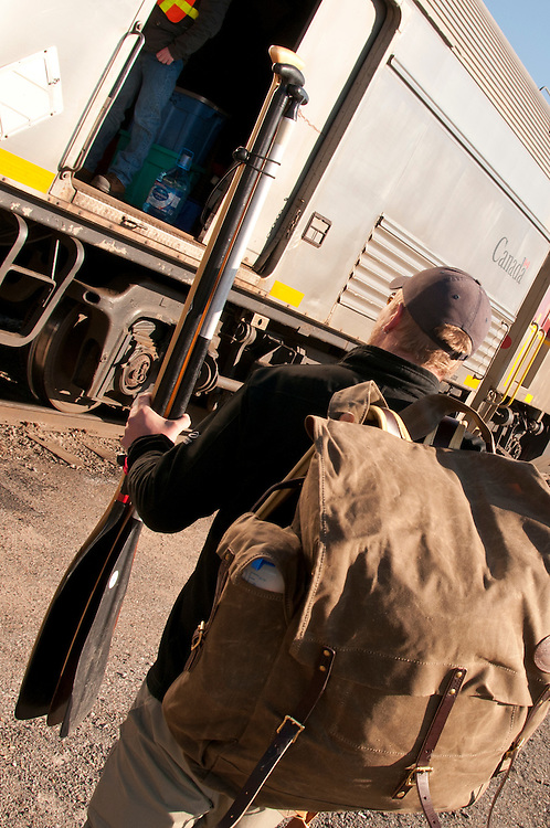 Loading equipment on a train for a wilderness canoe trip in Ontario Canada.