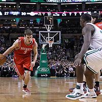06 March 2012: Houston Rockets point guard Goran Dragic (3) drives past Boston Celtics point guard Rajon Rondo (9) on a screen set by Houston Rockets power forward Luis Scola (4) during the Boston Celtics 97-92 (OT) victory over the Houston Rockets at the TD Garden, Boston, Massachusetts, USA.