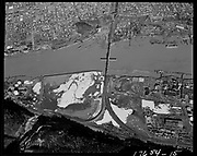 "ackroyd-17654-15. ""City  of Portland aerials. February 1, 1972"". ""Schnitzer. below RR bridge. Siltronic."" (DEQ Site ID 1120, 398, 183, Pennsylvania Salt Mfg. Co., Elf Atochem, Arkema, Atofina Chemicals, Pennwalt Chemical Corp.Schnitzer, Siltronic) Willbridge Tank Farm, SP&S Railroad bridge."