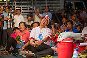 01 MARCH 2013 - BANGKOK, THAILAND: .A Thai man dozes during the last election rally of the Bangkok governor race. The election is Sunday, March 3 and no campaigning is allowed 24 hours before election day. Police General Pongsapat Pongcharoen (retired), a former deputy national police chief who also served as secretary-general of the Narcotics Control Board is the Pheu Thai Party candidate in the upcoming Bangkok governor's election. He resigned from the police force to run for Governor. Former Prime Minister Thaksin Shinawatra reportedly personally recruited Pongsapat. Most of Thailand's reputable polls have reported that Pongsapat is leading in the race and likely to defeat Sukhumbhand Paribatra, the Thai Democrats' candidate and incumbent. The loss of Bangkok would be a serious blow to the Democrats, whose national base has been the Bangkok area.    PHOTO BY JACK KURTZ