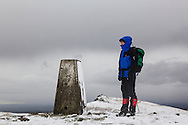 The trig point was once considered to be the true summit of Cadair Berwyn. But the true summit (Cadair Berwyn New Top, or Craig Uchaf, which was recognised in 1987) is across a slight dip, and visible in the background.