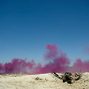 Afghan and Canadian soldiers in a trench mark their position with purple smoke during a drone strike on insurgents nearby, Panjwa'i District, Kandahar Province.<br /> (Credit Image: © Louie Palu/ZUMA Press)