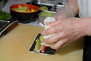 Chef prepares Sushi in a sushi restaurant