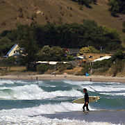 Surfers in action at Wainui Beach, near Gisborne. Wainui beach is world famous as a surfing beach, it's fantastic breaks and it's beautiful stretch of sand and sea..Wainui Beach, Gisborne, Hawkes Bay, New Zealand,, 15th January 2011. Photo Tim Clayton.