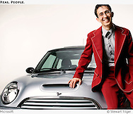 Man in red suit sitting on a Mini.