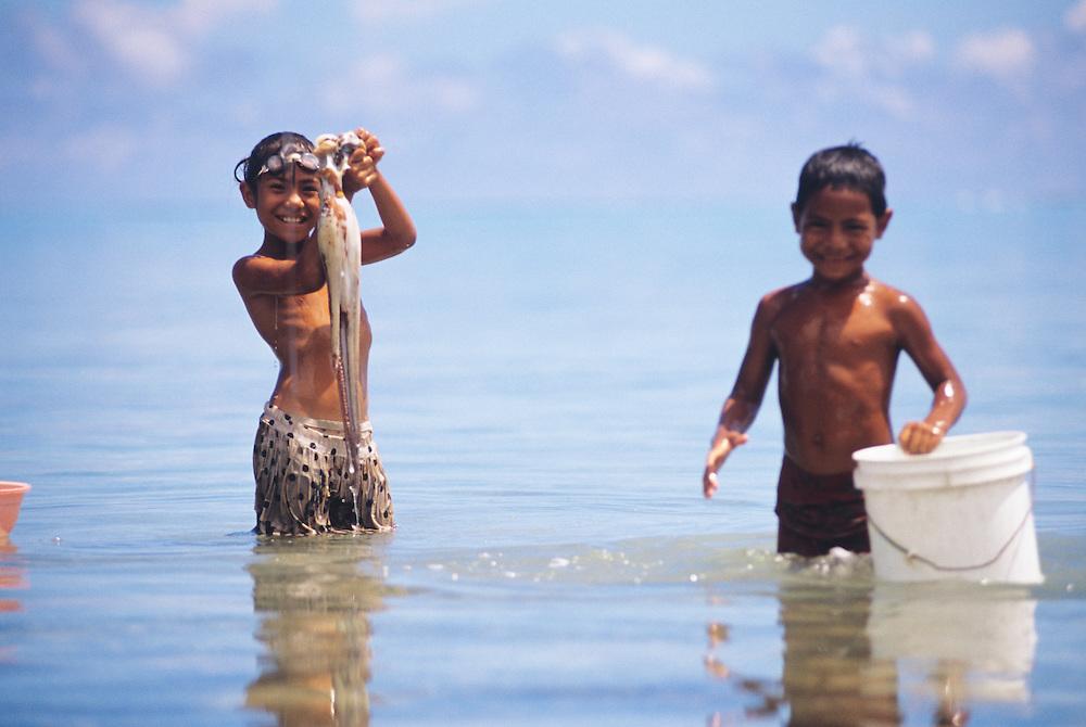 Western Samoa, Manono Island, village children, boy & girl fresh caught Octopus