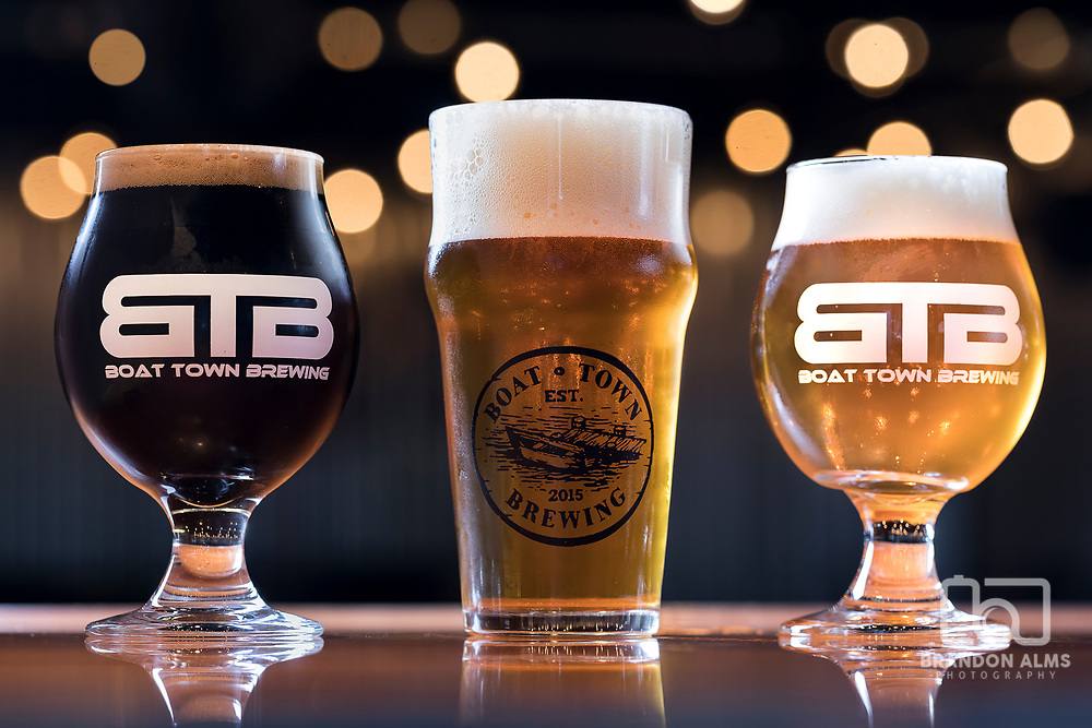 Photoshoot at Boat Town Brewing in Phillipsburg, MO on July 8, 2017. From left to right: Perficle (chocolatey Imperial Stout), Danny Down the Road (American Amber), and the Wanderlust (Seasonal Belgium Wit).