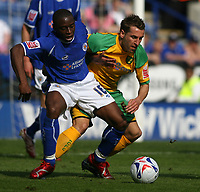 Photo: Pete Lorence.<br />Leicester City v Norwich City. Coca Cola Championship. 14/04/2007.<br />Shaun Newton and Darren Huckerby battle for the ball.