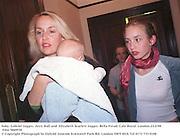 Baby Gabriel Jagger, Jerry Hall and  Elizabeth Scarlett Jagger. Bella Freud. Cafe Royal. London.23/2/98. Film 9849f30<br />© Copyright Photograph by Dafydd Jones<br />66 Stockwell Park Rd. London SW9 0DA<br />Tel 0171 733 0108