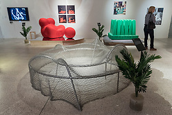 "© Licensed to London News Pictures. 06/11/2018. LONDON, UK. General view of display space featuring (clockwise, top left) ""Up Chair"", 1969, by Gaetano Pesce, ""Pratone"", 1971, by Ceretti, Derossi & Rossi, and ""Frame 03"", 2017, by SO-IL.  Preview of ""Home Futures"", at the Design Museum.  The exhibition, in partnership with IKEA Museum Almhult, asks are we living in the way that pioneering architects and designers once predicted, or has our idea of home proved resistant to real change?  More than 150 objects and experiences are on display 7 November to 24 March 2019.  Photo credit: Stephen Chung/LNP"