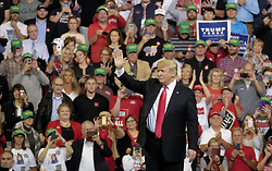 October 9, 2018 - Council Bluffs, Iowa, U.S. - President DONALD TRUMP (R) waves goodbye to attendees at a campaign Make America Great Again rally at the Mid-America Center. (Credit Image: © Jerry Mennenga/ZUMA Wire)