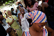 Callejon de Hamel, rhumba performance in Havana. Santeria is a syncretic religion practiced in Cuba, it is a mixture of Yoruba tribal practices brought from Nigeria during Colonial times, and traditional Catholic beliefs. During this time, the slaves used the images of saints to cover up their worship of the Orishas (spirits)