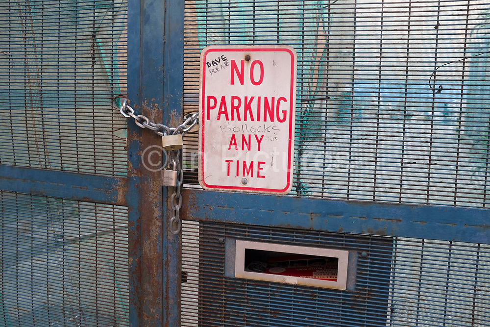 No parking at any time sign in London, UK. The sign has been defaced with amusing graffiti.