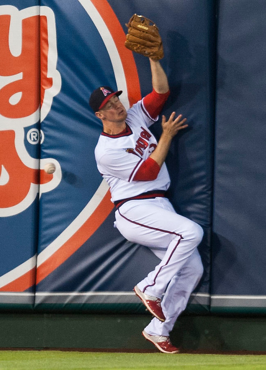 The Angels' Todd Cunningham can't make the catch on this Adrian Beltre RBI triple in the third inning against the Texas Rangers at Angel Stadium on Wednesday.<br /> <br /> ///ADDITIONAL INFO:   <br /> <br /> angels.0721.kjs  ---  Photo by KEVIN SULLIVAN / Orange County Register  -- 7/20/16<br /> <br /> The Los Angeles Angels take on the Texas Rangers at Angel Stadium.