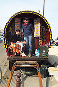 """Yan, a Dutch gypsy who has been traveling with a wagon and horse for nearly 40 years, pictured with Esmeralda Romanes, a militant activist defending Roma rights across France<br /><br />""""Le Pelerinage des Gitans""""; the French gypsy pilgrimage of Saintes Maries de la Mer, Camargue, France<br /><br />Sainte Sara is an uncannonized saint, who legend says looked after the Christian Saints Marie Jacobe and Marie Salome, cousins of Mary Magdalene, who arrived, it is said, on the shores of the Camargue in a rudderless boat. Saint Sara is the patron saint of gypsies who come from far and wide to see her. There are even paintings of Sara as 'Kali' the black saint in Eastern Europe. Sara may have been the priestess of 'Ra' the sun-god or even servant girl to the Christian saints. No-one really knows.<br /><br />For a few weeks of the year, Roma, Gitan and Manouche gypsies come from all over Europe in May, camping in caravans around Saintes Maries de la Mer. It is a festive time where they play music, dance, party and christen their children. They all go to see Saint Sara in the crypt, kissing or touching her forehead. Many put robes on her shoulders, making her fat for the procession. In the main Gypsy procession of the 24th May, Saint Sara is allowed to leave her crypt, beneath the church, and is carried from the church to the shores of the mediterranean and back again. One day a year she is free from her prison. Hundred's of years ago the Gypsies used not even to be allowed into the church, only into the crypt like Sara...<br /><br />Roma gypsies still suffer oppressive prejudice and racism and are one of the ethnic groups the most persecuted and marginalised across Europe. The festival is one of the times where they celebrate with people of all races, their faith and traditions"""