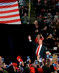 Hershey, PA, USA - Dec. 15, 2016; President-Elect Donald Trump greets supporters as he exits after appearing on stage at a post-election Thank You Tour event with Vice-President-Elect Mike Pence, at the Giant Center in Hershey, PA.