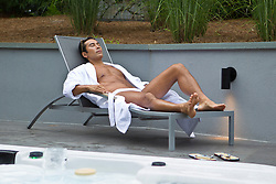 man enjoying time alone on a lounge chair at a spa