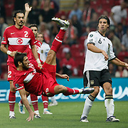 Turkey's Egemen KORKMAZ (L) and Germany's Sami KHEDIRA (R) during their UEFA EURO 2012 Qualifying round Group A matchday 19 soccer match Turkey betwen Germany at TT Arena in Istanbul October 7, 2011. Photo by TURKPIX