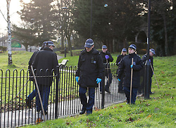 © Licensed to London News Pictures. 15/12/2014. Police officers search for evidence in Edmonton Green, nearby the murder scene where a man was stabbed at his home in Brickland Court, The Broadway, north London, UK. Photo credit : Isabel Infantes / LNP