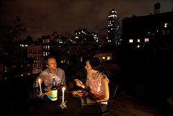 Rob Gallagher and wife Lillian Coryn enjoy dinner on the roof of their home in Soho, New York, N.Y., Sept. 16, 2011.