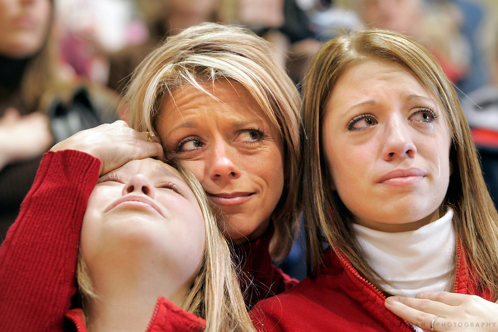 Heidi Zulaica wraps her arms around her daughters Makayla, 10, left, and Hailie, 17, all of Johnson, Iowa, as they wait to greet husband and father Sgt. David Zulaica of the 224 Engineering Battalion during the welcome home ceremony Saturday December 17, 2005 at Southeastern Community College in West Burlington, Iowa. Scott Morgan | The Hawk Eye