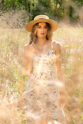 Fashion photography of a model in a field. Photo by Brandon Alms Photography