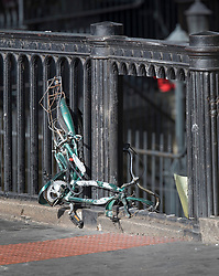 © Licensed to London News Pictures. 05/06/2017. London, UK. The remains of a crushed bicycle lie on railings at the exact spot where a van crashed after running down people on London Bridge during a terrorist attack Saturday evening. A section of the railings has been removed by the emergency services.  Three men attacked members of the public  after a white van rammed pedestrians on London Bridge.   Ten people including the three suspected attackers were killed and 48 injured in the attack. Photo credit: Peter Macdiarmid/LNP