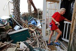 August 27, 2017 - Port Aransas, Texas, U.S. - Port Aransas resident MELANIE ZURWASKI walks into her home in aftermath of Hurricane Harvey. Zurwaski's home was destroyed but she managed to get through the category four storm. (Credit Image: © San Antonio Express-News via ZUMA Wire)