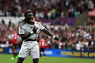 Bafetimbi Gomis of Swansea city celebrates after he scores his teams 2nd goal. Barclays Premier League match, Swansea city v Manchester Utd at the Liberty Stadium in Swansea, South Wales on Sunday 30th August  2015.<br /> pic by Andrew Orchard, Andrew Orchard sports photography.