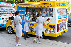 © Licensed to London News Pictures; 05/07/2020; Bristol, UK. Emergency Service workers clap and are served ice creams by Mr Nicks Ice Cream outside the Bristol Royal Infirmary Hospital at 5pm on Sunday afternoon as part of a nationwide tribute to NHS staff on the 72nd anniversary of the health service and as a thank you to NHS health service workers during the coronavirus Covid-19 pandemic. The National Health Service was launched on 5 July 1948, with the core principle that it is free at the point of delivery and is based on clinical need. Photo credit: Simon Chapman/LNP.