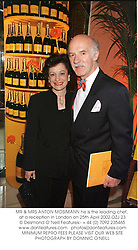 MR & MRS ANTON MOSIMANN he is the leading chef, at a reception in London on 25th April 2002.OZJ 23