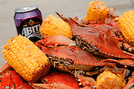 Boiled Gulf crabs and corn, with a side of Abita Beer Purple Haze, on the set of a Monday Night Football commercial at Rouses Markets in New Orleans, LA.