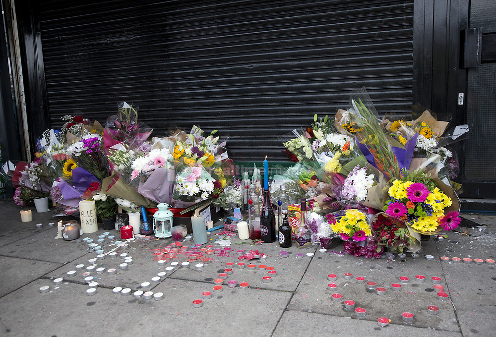 July 24, 2017 - London, LONDON, UK - LONDON, UK.  Floral tributes are laid outside the shop in Kingsland Road, Dalston, east London, where 20-year-old Rashan Charles died after being chased by police in the early hours of Saturday morning. (Credit Image: © Isabel Infantes/London News Pictures via ZUMA Wire)