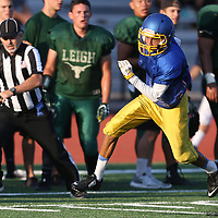 (Photograph by Bill Gerth/ for SVCN/8/18/17)  Prospect's Joel Zuniga looks for yardage at the BVAL Football Jamboree at Leigh High School, San Jose CA on 8/18/17.