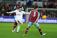 Gylfi Sigurdsson of Swansea city shoots from long range. Barclays Premier league match, Swansea city v West Ham Utd at the Liberty Stadium in Swansea, South Wales  on Sunday 20th December 2015.<br /> pic by  Andrew Orchard, Andrew Orchard sports photography.
