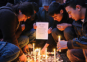 Asylum seekers and residents of Glasgow's infamous Red Road Flats hold a candle lit vigil after a Russian family led by their father Serge Serykh let to their death.<br /> <br /> They hold a sign saying 'We Died For Freedom'<br /> <br /> © John Linton<br /> All rights reserved