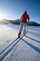 Young woman cross country skiing near Silverton, CO