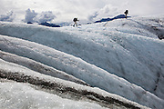 Parmenter and Liana Welty hike out across the Root Glacier, Wrangell-St. Elias National Park, Alaska.