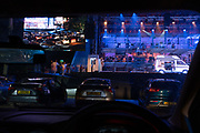 Seen from the driver's seat, Puccini's La bohème is performed by members of  English National Opera (ENO) as a drive-in (ENO Drive and Live) at Alexandra Palace, on 18th September 2020, in London, England. This is ENO's first public performance since the closure of their West End Colisseum home venue, because of the Coronavirus pandemic lockdown in March. This is Europe's first live drive-in opera production that audiences can safely experience from their cars and ENO's first public performance since the closure of their West End Colisseum home venue, because of the Coronavirus pandemic lockdown in March. As per the latest government advice. Each bubbled group consists of; 34 members of the<br /> ENO Orchestra, 20 ENO Chorus members and 8 principals. Each bubble has its own individual crew to oversee their rehearsals and performances.