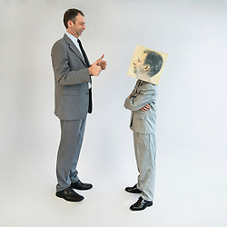 Businessman showing thumbs up to boy wearing mask