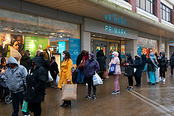 Motherwell, Scotland, UK. 1 November 2020. The Scottish Government today announced that from Friday 20 November, the most severe level 4 lockdown will be introduced in eleven Scottish council areas. This means non essential shops will close and bars, restaurants and cafes. Pictured; Long queue outside Primark store. Non essential shops will close.   Iain Masterton/Alamy Live News